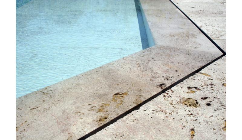 construcción de piscina proyecto Naipí Dekton